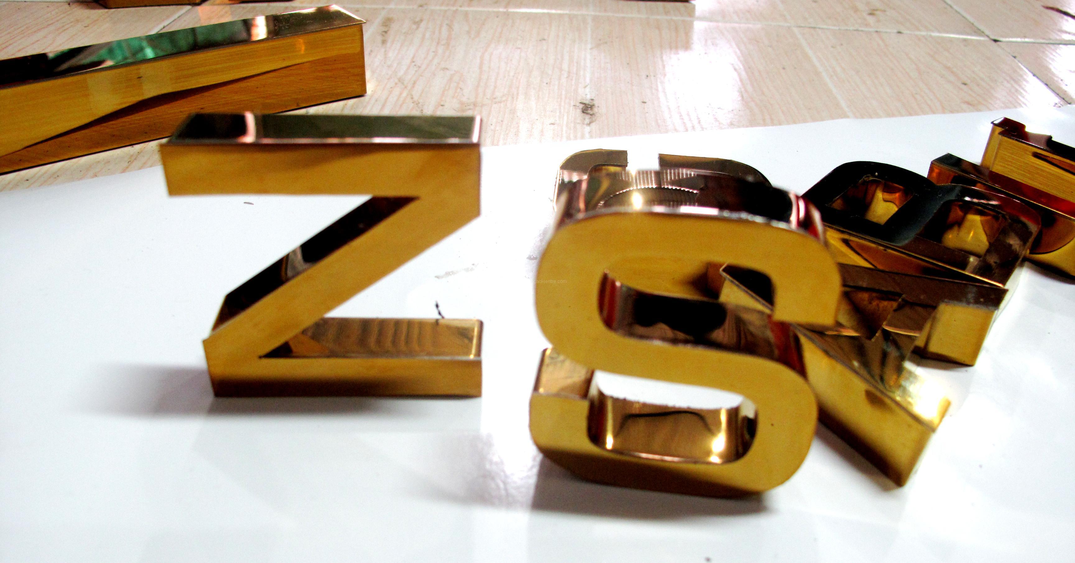 bảng hiệu inox vàng,